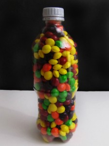 Candy filled plastic bottle