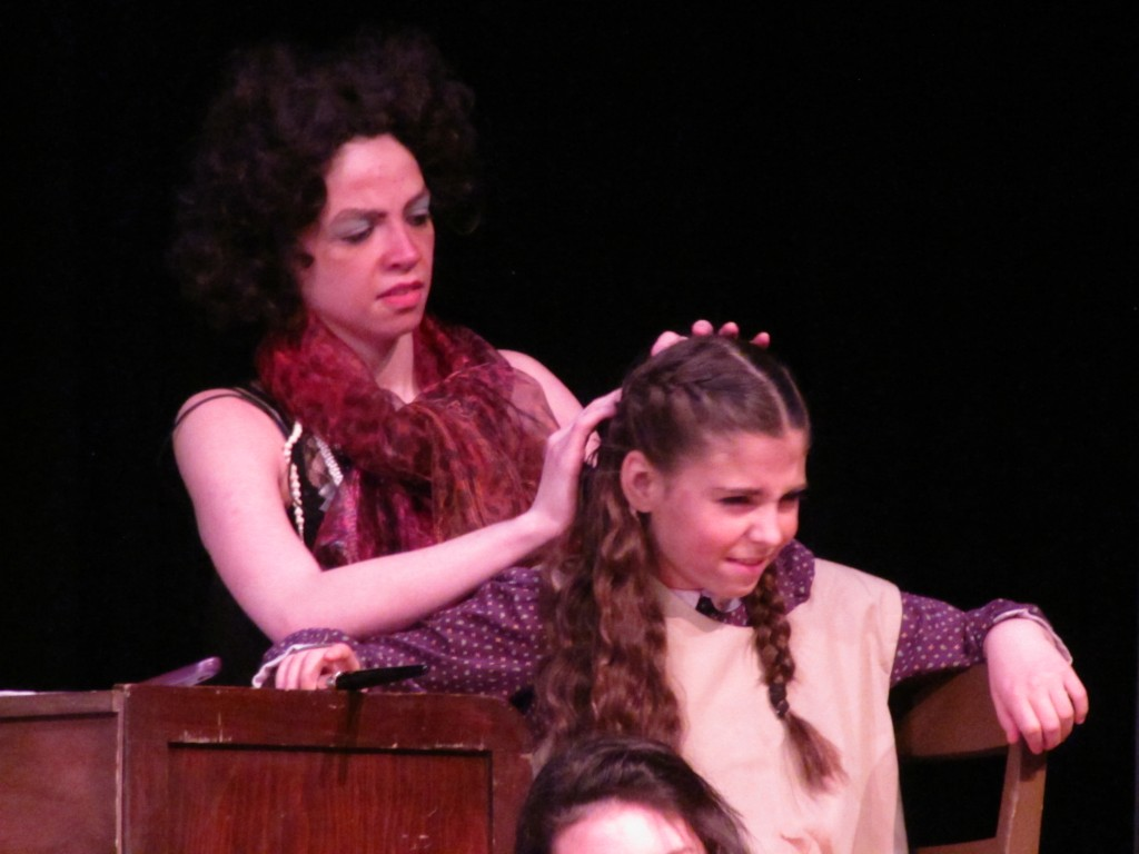 There's Princess getting her hair brushed by Mrs Hannigan.