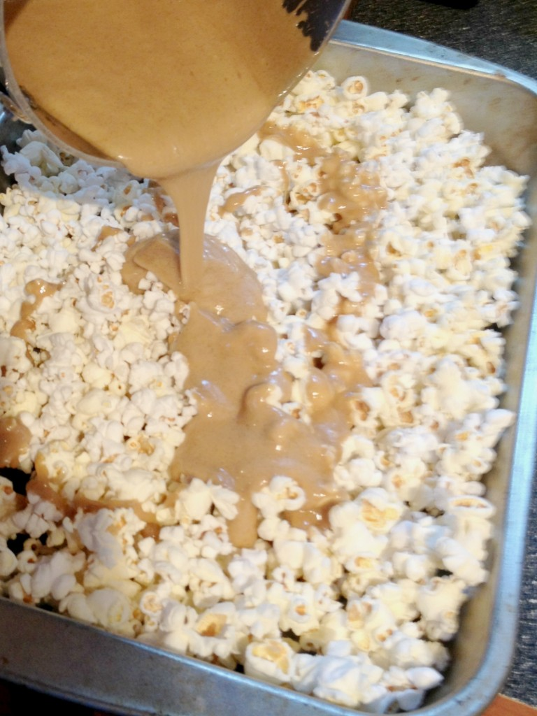 Pouring caramel over popcorn